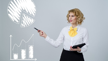 IENT101 Course Image: Image of female entrepreneur depicting presentation using bar and pie chart